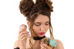 Sexy brunette woman with fashion curly hair with ice cream in hand Stock Photography