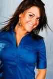 brunette woman fashion model in blue shirt stock photo