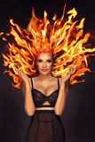 brunette woman with fire on head stock images