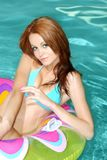 Sexy Brunette Woman Floating On Pool Toy Stock Image