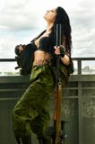 Sexy brunette woman with gun Stock Photography