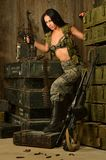 Sexy brunette woman with gun Royalty Free Stock Photo