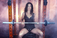 Sexy brunette woman in the gym. Royalty Free Stock Images