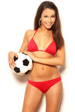 brunette woman holding ball in studio Royalty Free Stock Photos