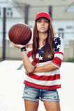 Sexy brunette woman holding basketball in hand Royalty Free Stock Photography