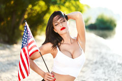 brunette woman holding USA flag outdoor Stock Photos
