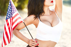 Sexy brunette woman holding USA flag outdoor closeup Stock Image