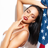 Sexy brunette woman holding USA flag Royalty Free Stock Photo