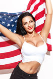 Sexy brunette woman holding USA flag Stock Photos