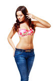 Brunette woman in jeans and bra Royalty Free Stock Photo