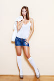 Sexy brunette woman in jeans short Royalty Free Stock Photography