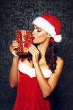 Sexy brunette woman kiss Christmas gift Stock Photos