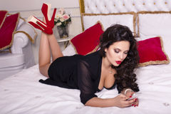 brunette woman in lingerie lying in the bed Royalty Free Stock Photo
