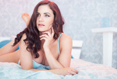 Sexy brunette woman in lingerie posing in bedroom Royalty Free Stock Photo