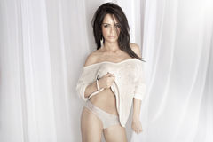 Sexy brunette woman looking at camera, posing. Royalty Free Stock Photography