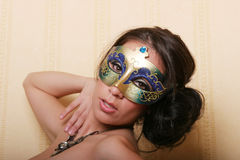 Sexy brunette woman in mask Stock Photo
