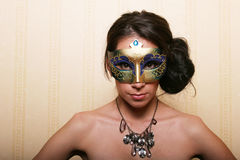 Sexy brunette woman in mask Stock Photography