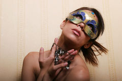Sexy brunette woman in mask Royalty Free Stock Photos