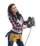 Sexy brunette woman mechanic with circular saw Royalty Free Stock Photos