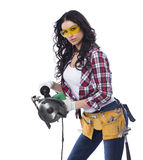 Sexy brunette woman mechanic with circular saw Stock Photos