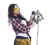 Sexy brunette woman mechanic with circular saw Stock Images