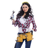 Sexy brunette woman mechanic with a wrench Royalty Free Stock Photos