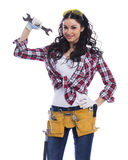Sexy brunette woman mechanic with a wrench Royalty Free Stock Images