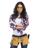 Sexy brunette woman mechanic with yellow safety glasses Royalty Free Stock Photography