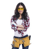 Sexy brunette woman mechanic with yellow safety glasses Royalty Free Stock Photo
