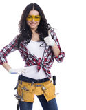 Sexy brunette woman mechanic with yellow safety glasses Stock Images