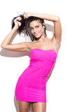Sexy brunette woman in pink dress Royalty Free Stock Photo