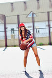 Sexy brunette woman playing basketball outdoor Stock Photo