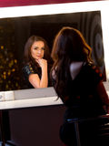 Sexy brunette woman posing in dark room at mirror Stock Photo