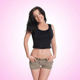 Sexy brunette woman posing in hot pants Royalty Free Stock Photos