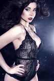 Sexy brunette woman posing in lingerie Stock Images