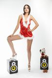 Sexy brunette woman posing in santa costume red Royalty Free Stock Images