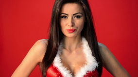Sexy Brunette Woman in Red Christmas Outfit Posing Isolated stock video footage