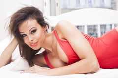 Sexy brunette woman in red lingerie Royalty Free Stock Photos