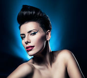 Sexy brunette woman with red lips in blue Stock Photography
