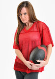 brunette woman in red mesh football jersey Stock Photos