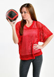 brunette woman in red mesh football jersey Stock Images