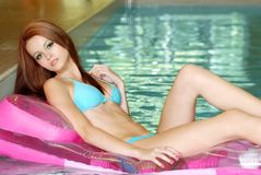 Sexy Brunette Woman Relaxing In Swimming Pool Stock Photography