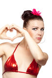 Sexy brunette woman showing heart shape Royalty Free Stock Photography