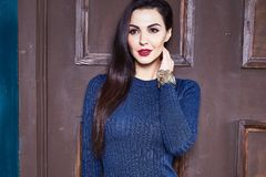 Sexy brunette woman skinny business style dress blue knit. Perfect body shape diet busy glamour lady casual style secretary diplomatic protocol office uniform Royalty Free Stock Photos