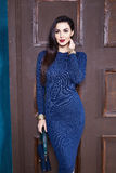 Sexy brunette woman skinny business style dress blue knit Royalty Free Stock Photo