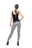 Sexy brunette woman in striped leggings Royalty Free Stock Images