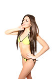 Sexy brunette woman in a swimsuit posing on a white background Stock Photography
