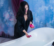 brunette woman taking off her clothes before bath Stock Image