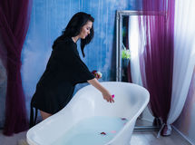 brunette woman taking off her clothes before bath Royalty Free Stock Photo