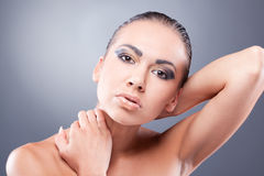 Sexy brunette woman touching neck Stock Photography